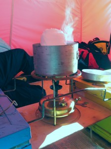 Melting snow on the Primus stove in the tent